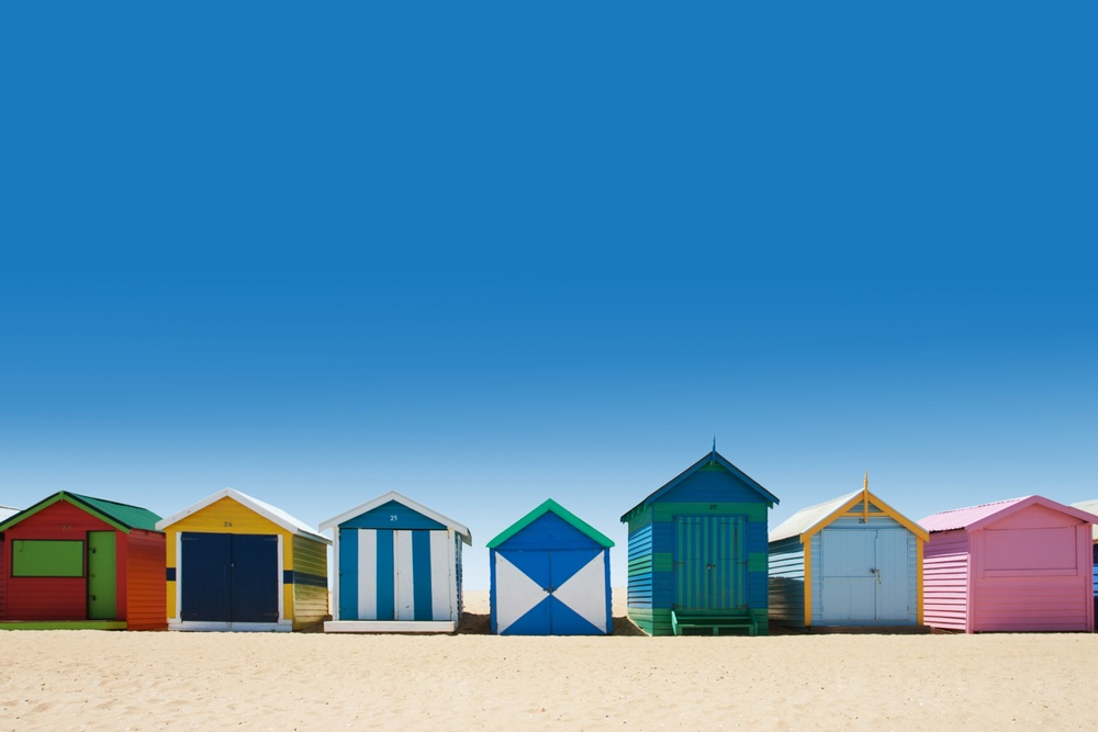 color houses on a white sandy beach in australia