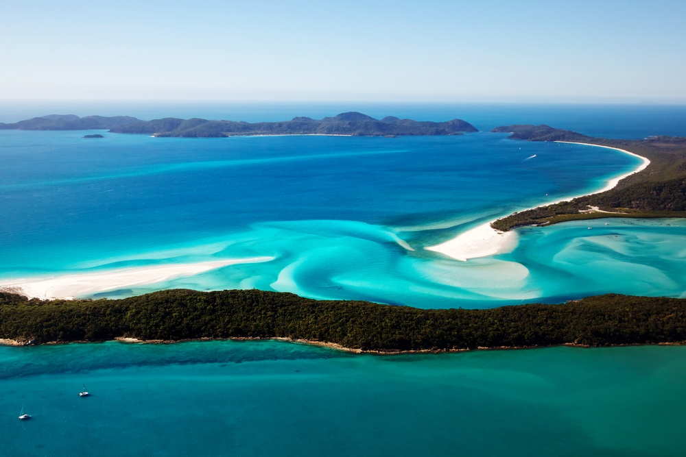 beautiful aerial view of islands off the coast of Australia with turquoise waters