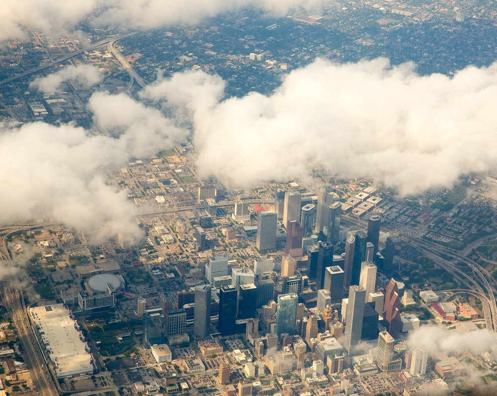 clouds hanging over a city
