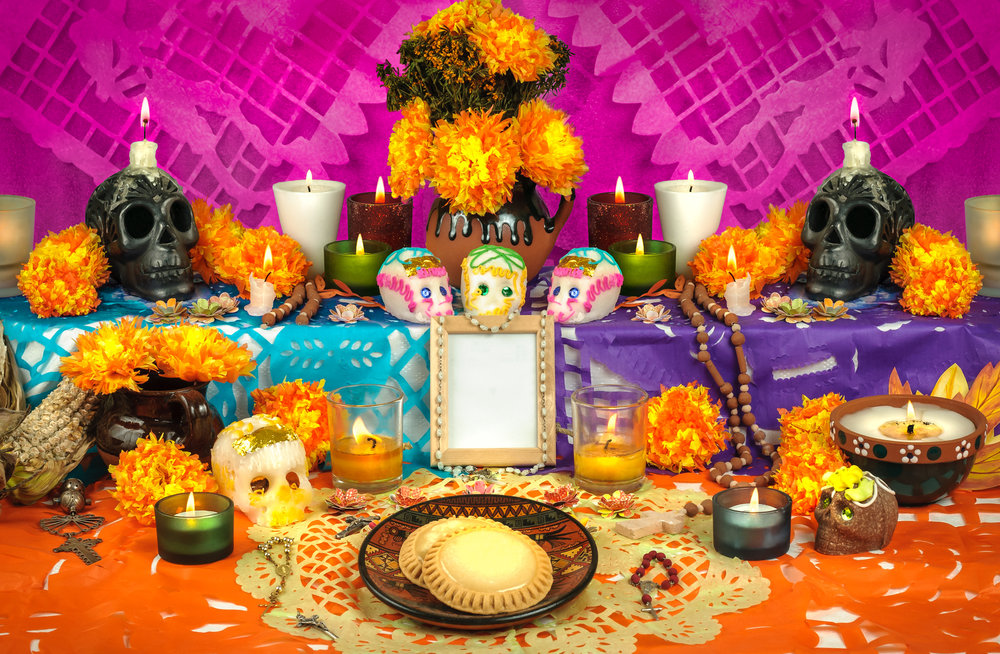 altar set up with skull candy and flowers for the deay of the dead celebration in patzcuaro mexico