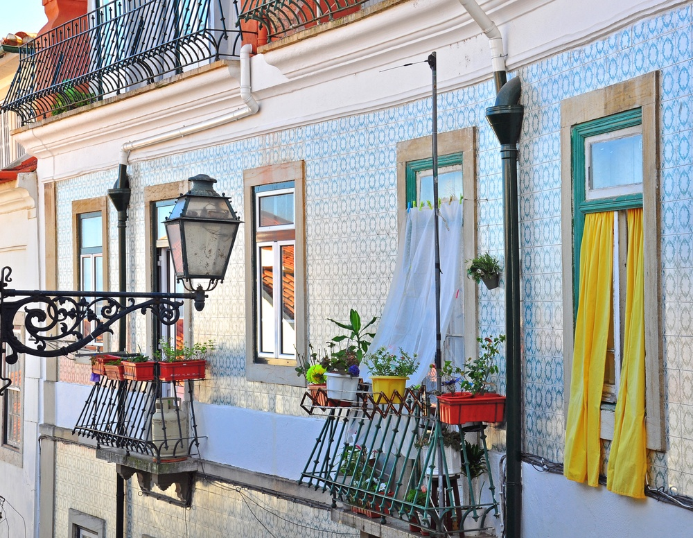 charming street in lisbon with colorful houses and balconies