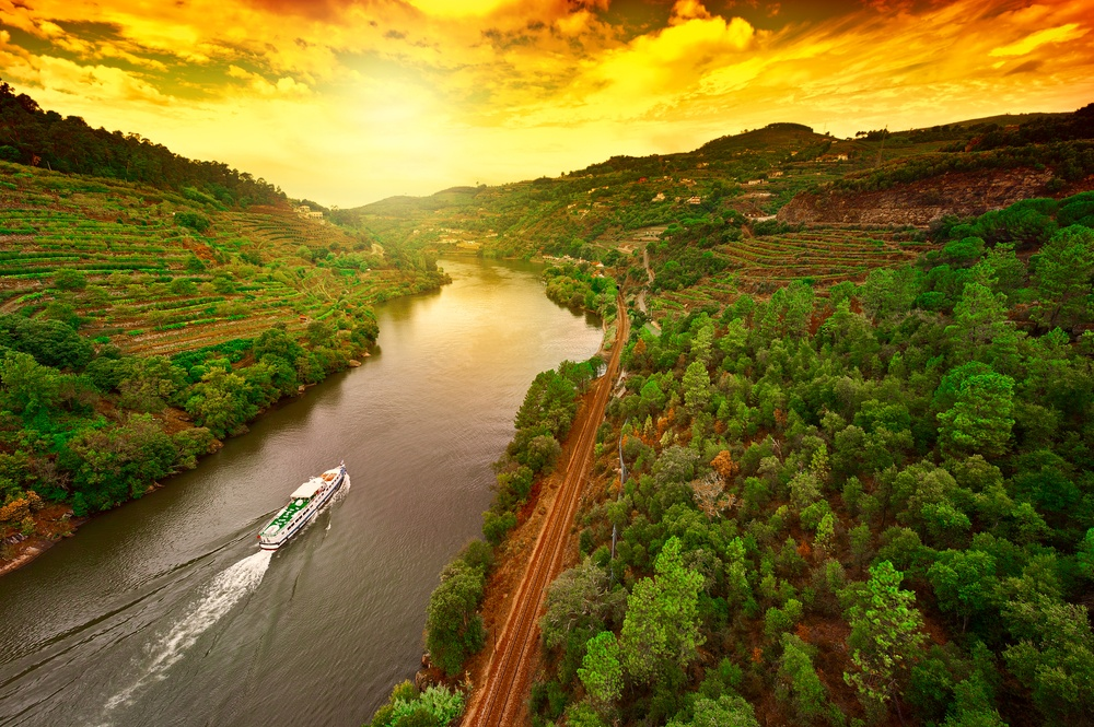 boat going through the duoro river in portugal