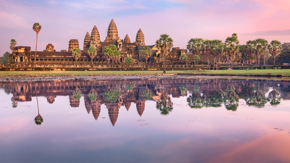 beautiful view of cambodian monasteries in a purple sunset light