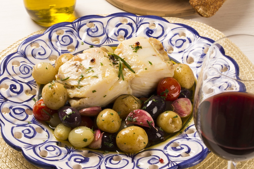 delicious plate of grilled fish with olives and potatoes in Lisbon