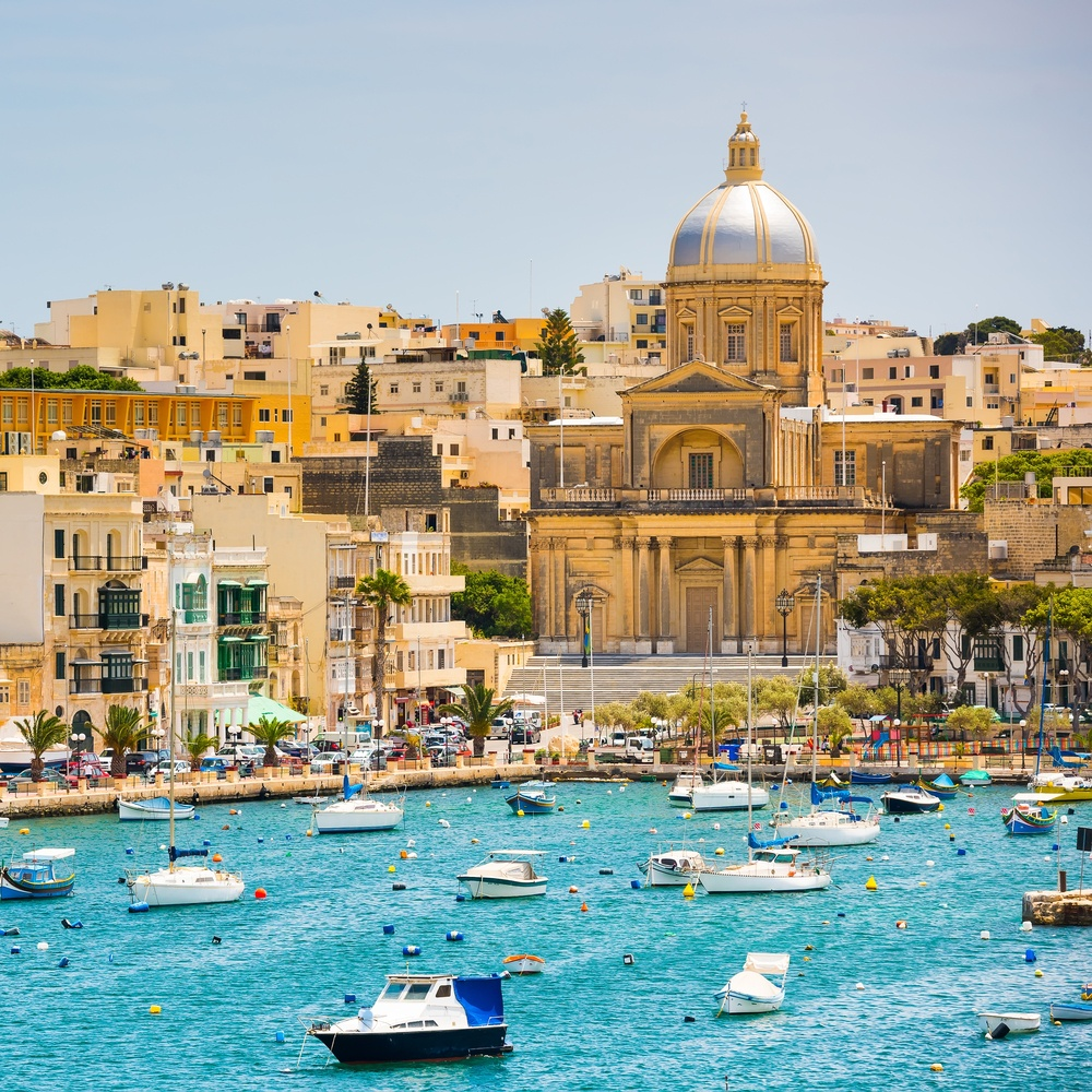 view of Valletta in Malta from the water with boats on the water