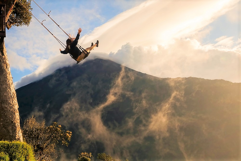 girl on swing with amazing background of Ecuador's mountains