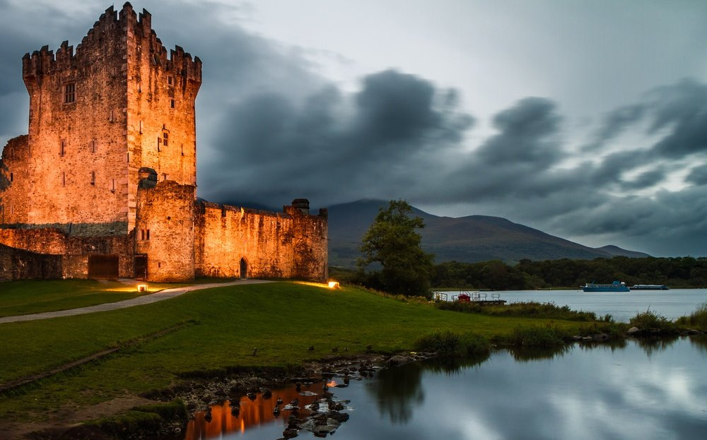 Ross Castle illuminated which you can Airbnb in Ireland