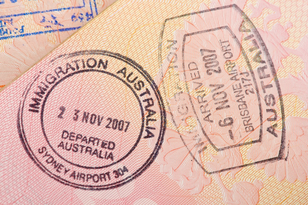photos of visas for Australia with stamps all over them