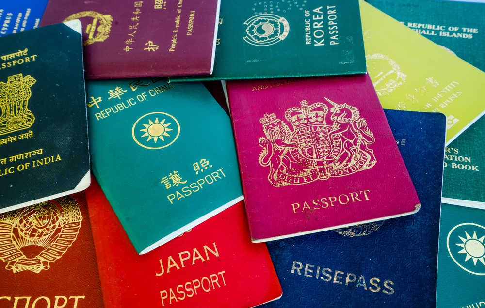 pile of passports from different countries