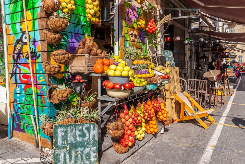 local street market showing fresh produce and other fruits being sold