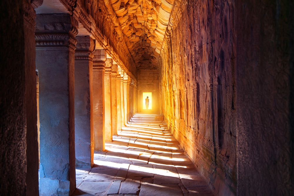 epic light at the end of a walkway in a monastery in cambodia
