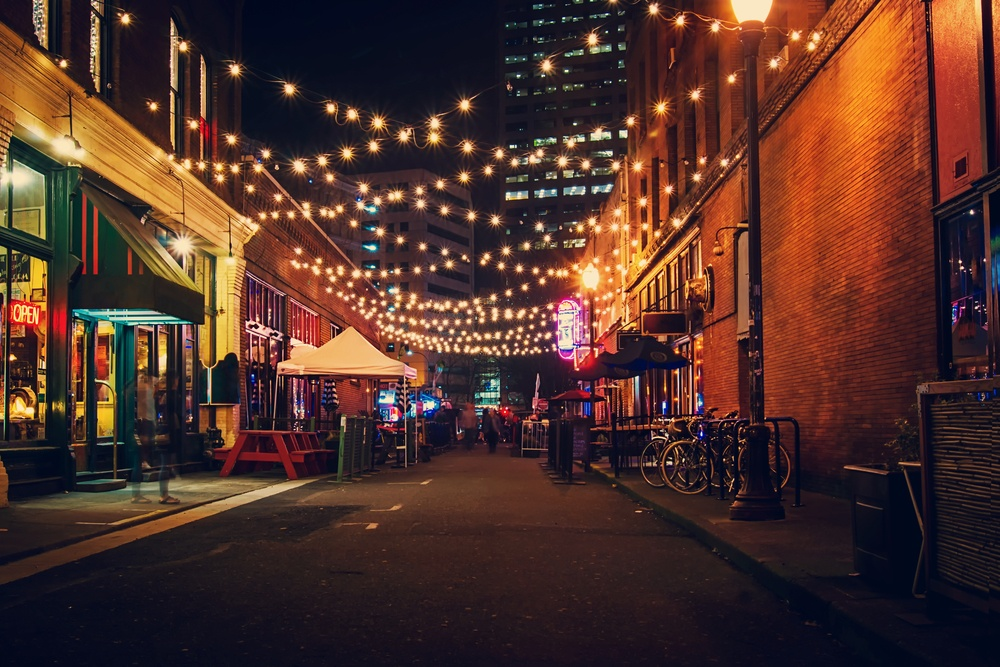 vibrant street with hanging lights in Portland Oregon at night