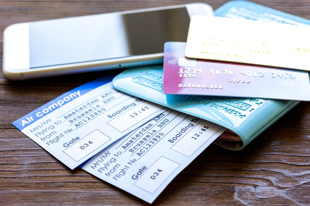 flight tickets with passport and phone
