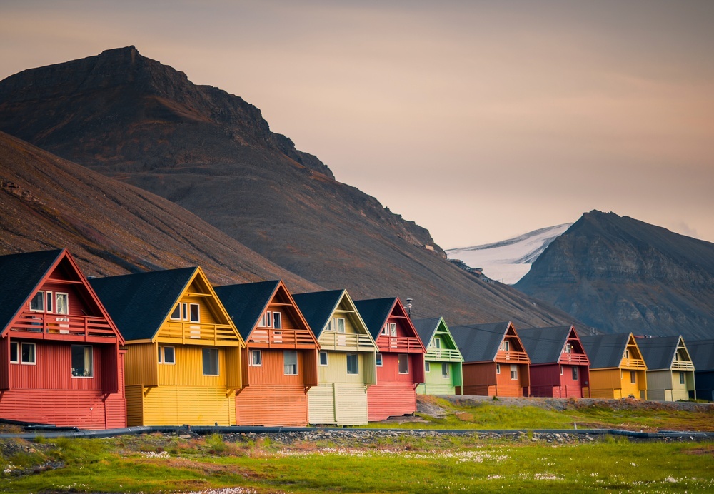 vibrant colorful houses with mountains in the background in Svalbard Norway