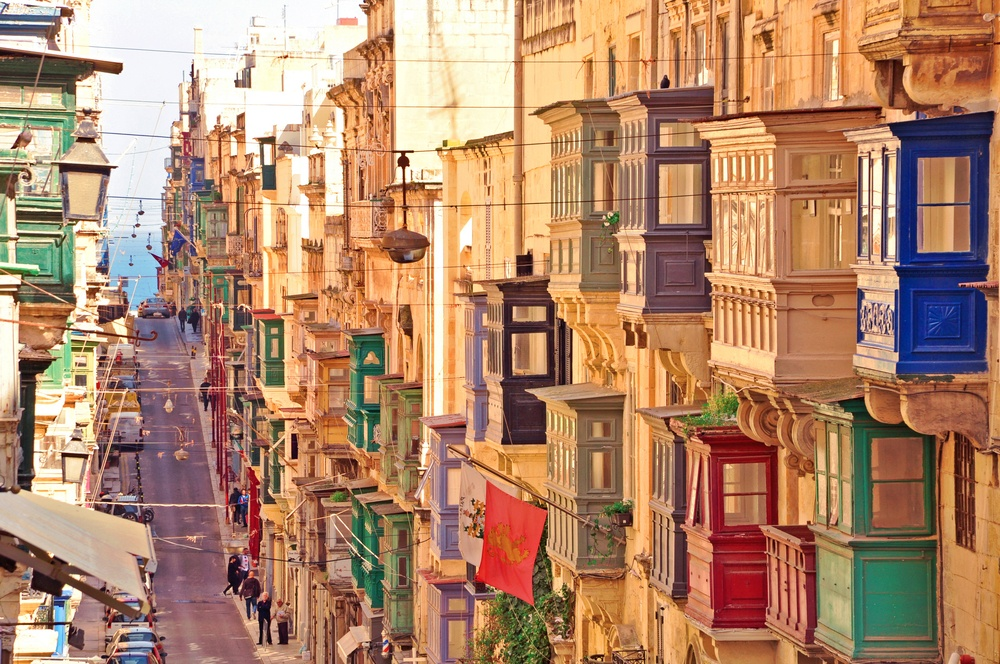 street in valletta with colorful balconies