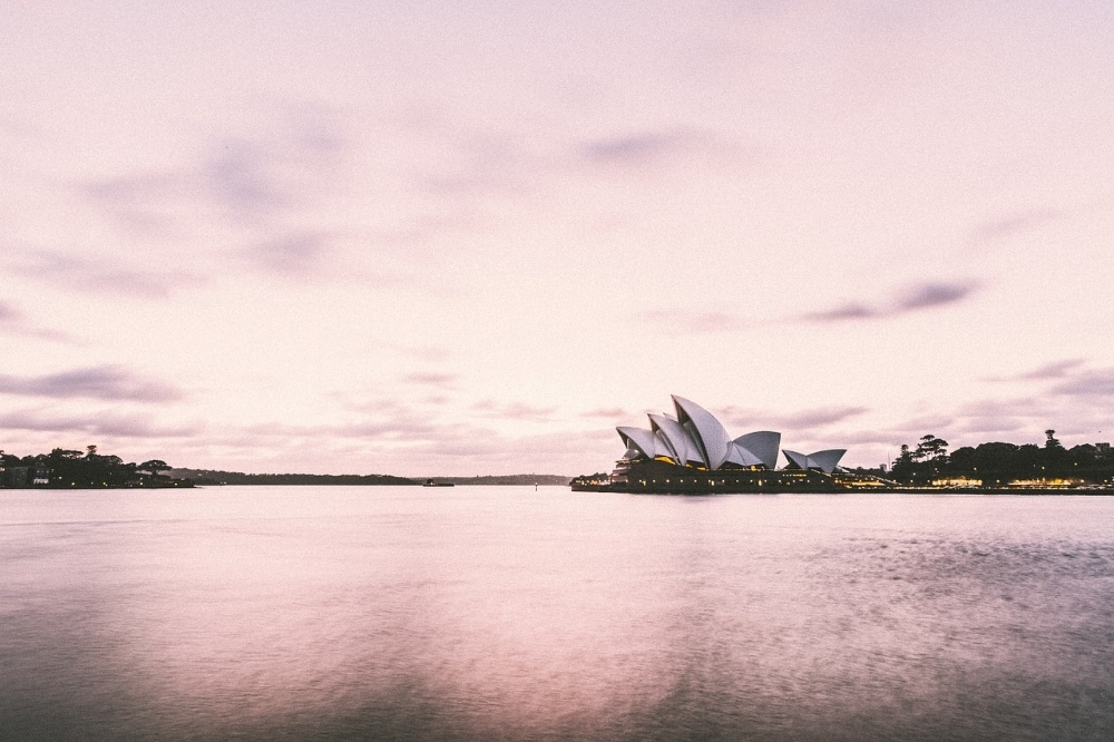 afternoon lighting on the opera house in Sydney Australia