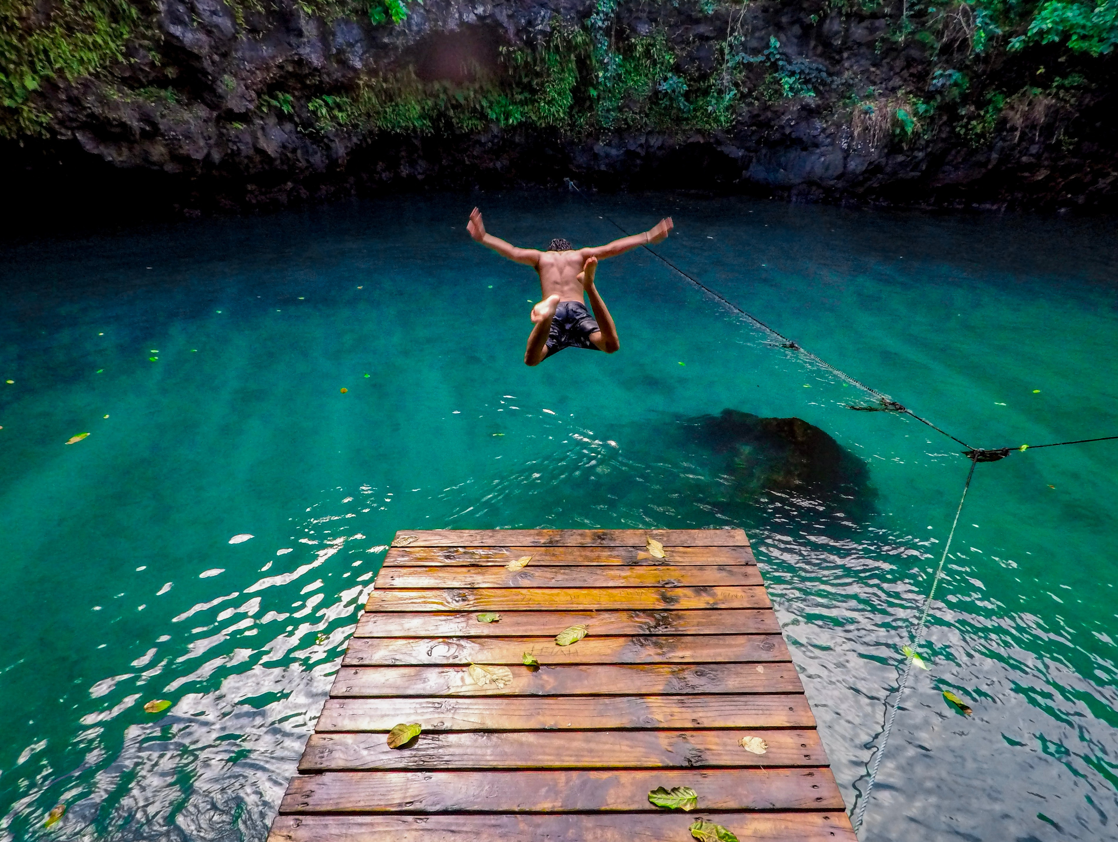 Jumping into the water off a dock in Samoa