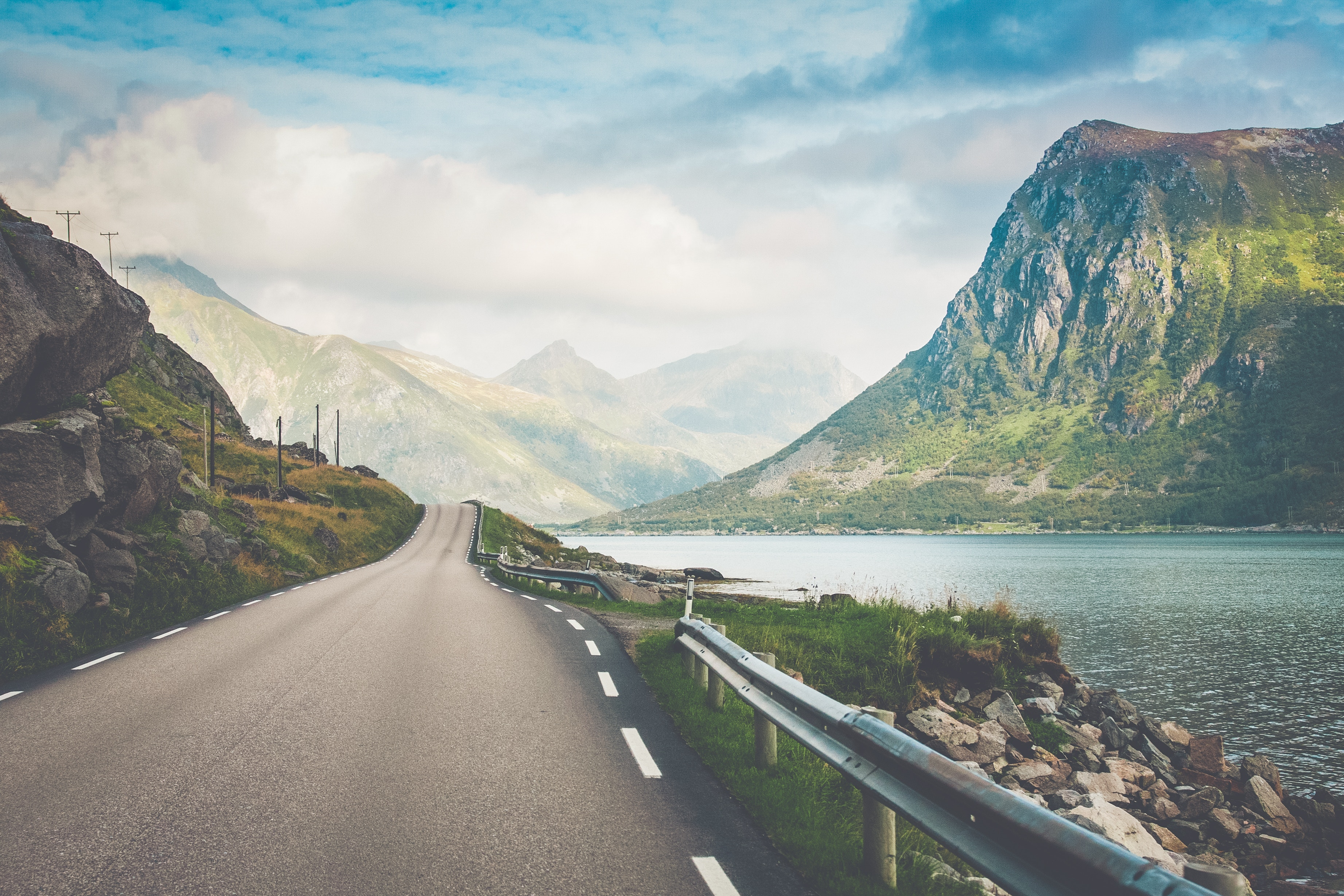epic road through the mountains in Lofoten, Norway