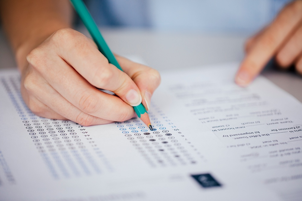 student-taking-test-on-paper