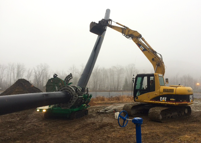 Excavator with HDPE Pipe