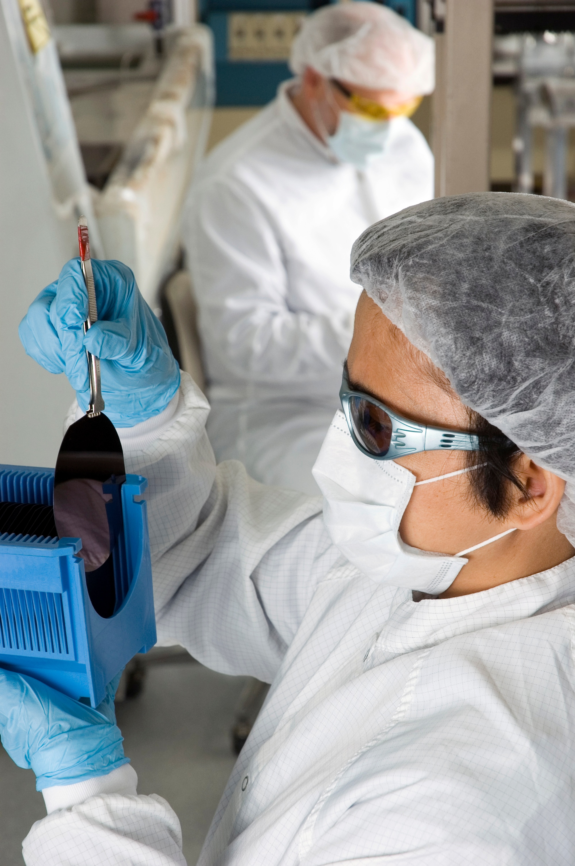 Lab-Technician-Inspecting-a-Silicon-Wafer--Series-000002529634_Large.jpg