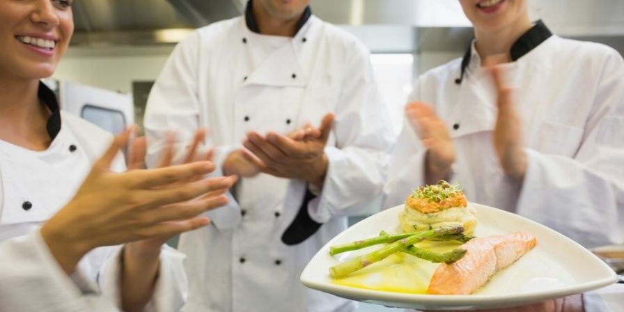 Young chefs applauding a salmon dish in commercial kitchen-532350-edited.jpeg