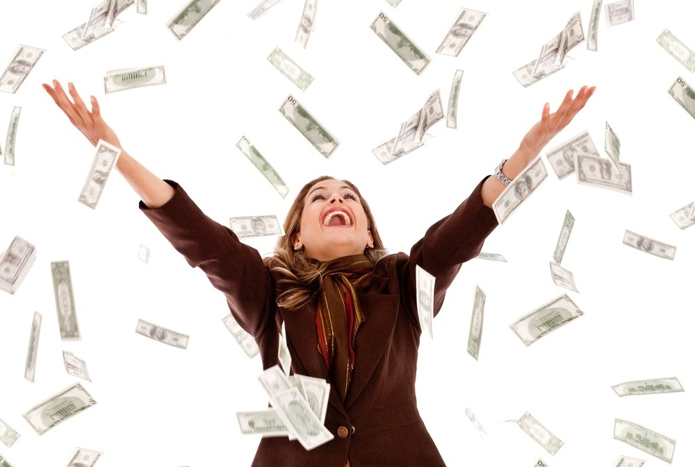 Business woman under a money rain - isolated over a white background-112781-edited.jpeg