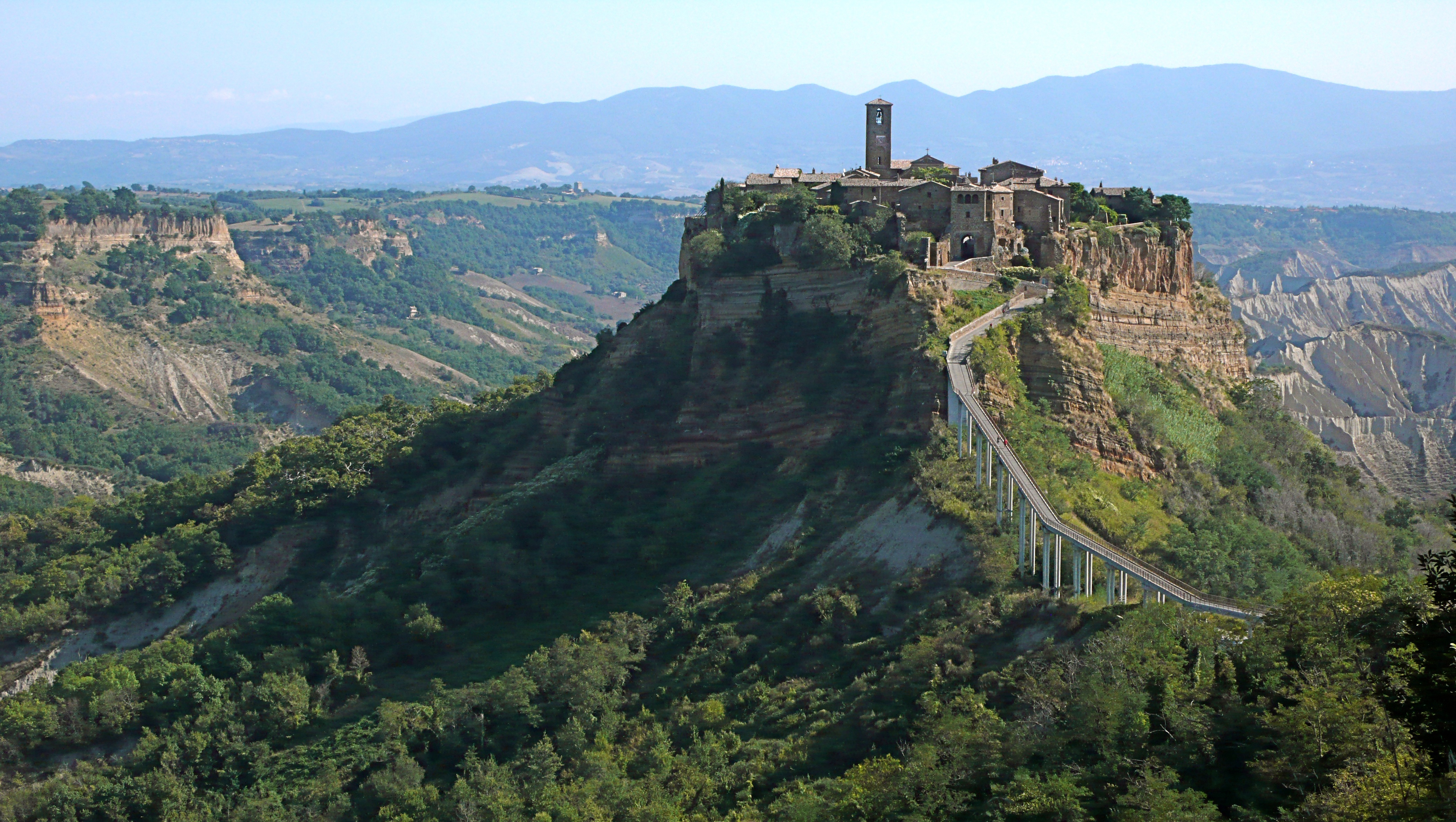 A distant photograph of Civita di Bagnoregio in Italy.