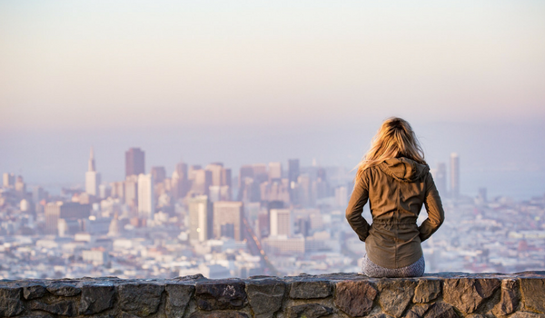 Woman Enjoying View of City Below