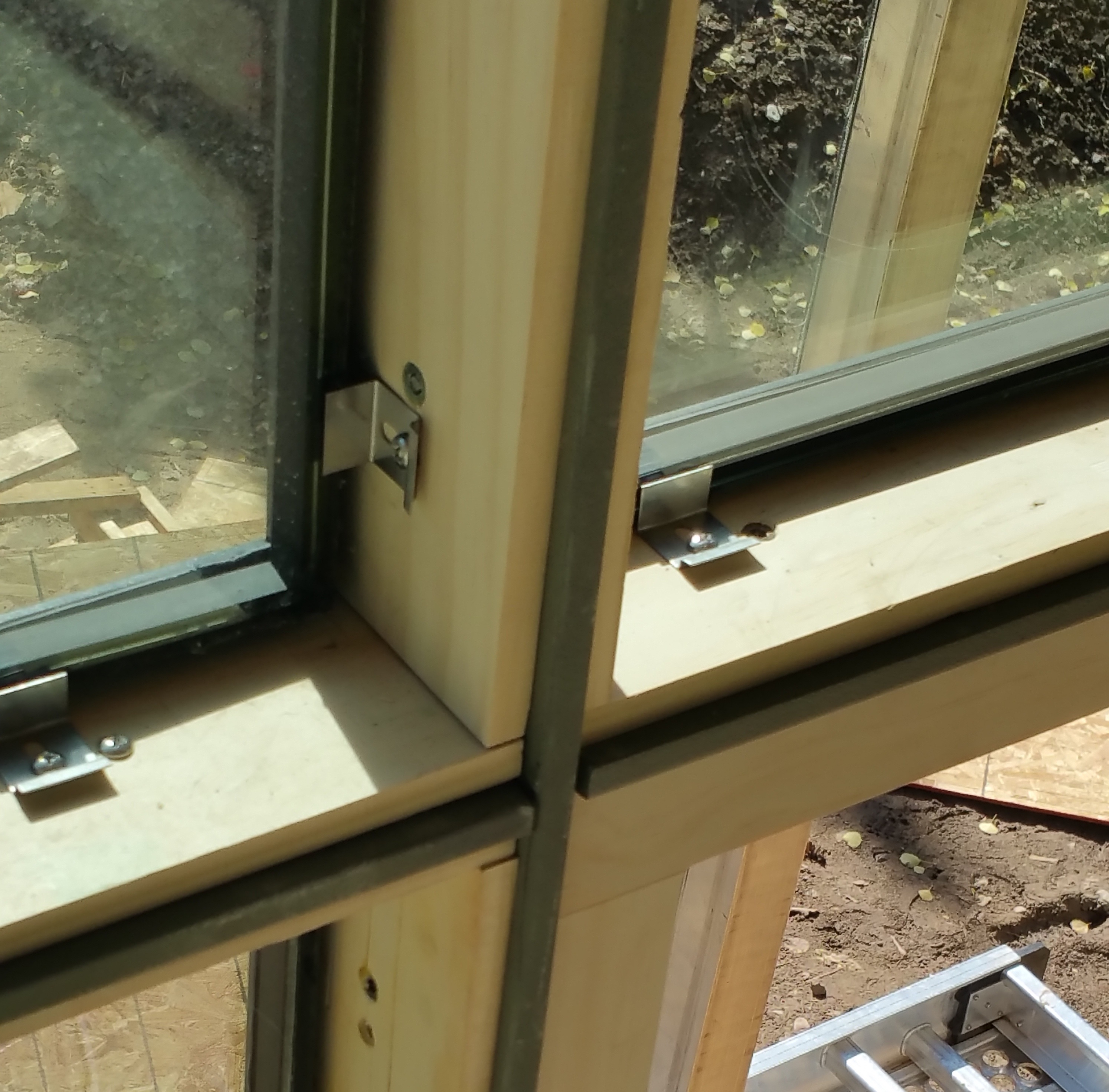 2Fold fixed window wall with glazing beads removed exposing mounting screws.