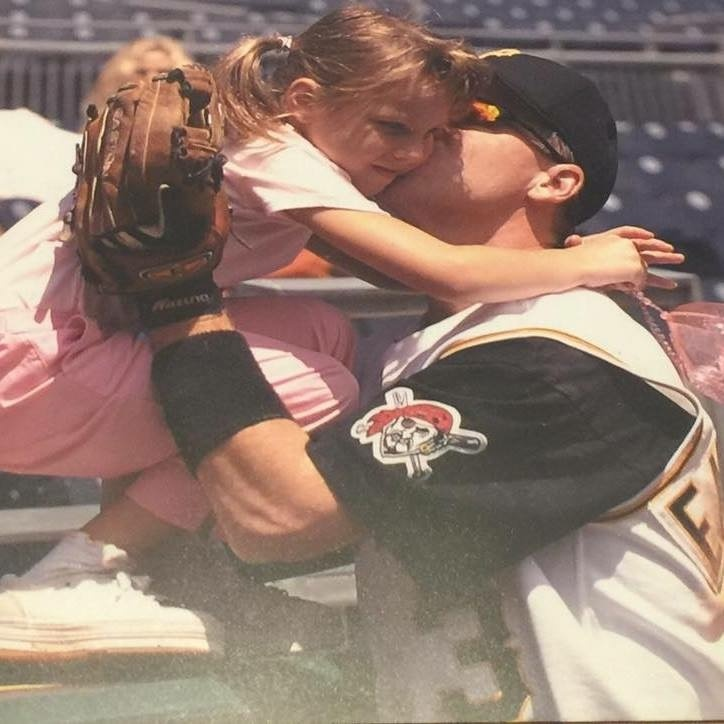 EM Media's agencies' daughter getting a kiss from a Pittsburgh Pirates