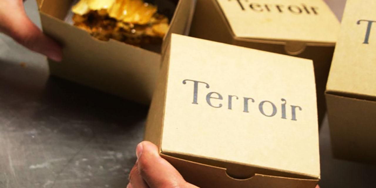 To-go boxes containing baklava