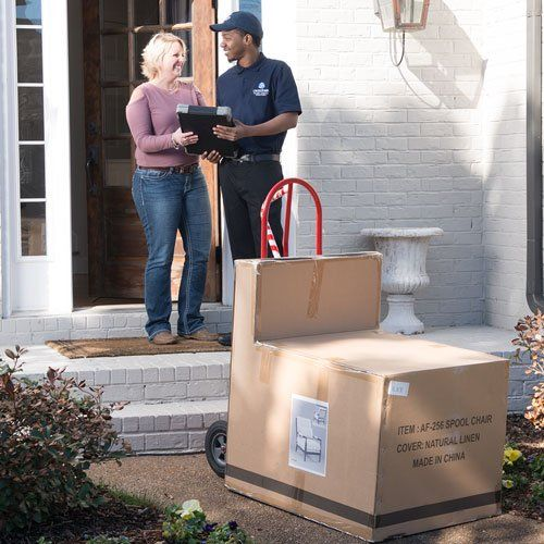 Photo of Averitt agent performing white glove delivery services