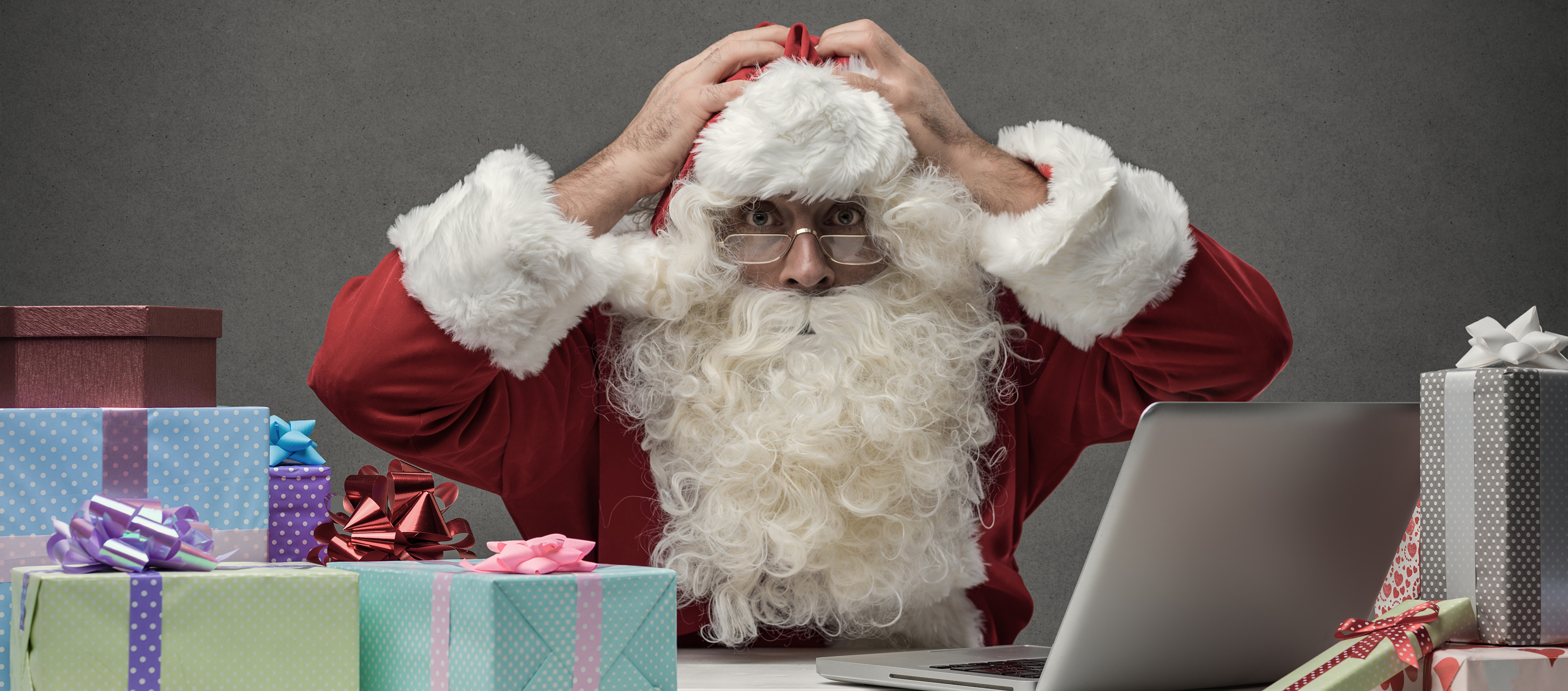 Canva - Stressed Santa connecting with his laptop (1)-2