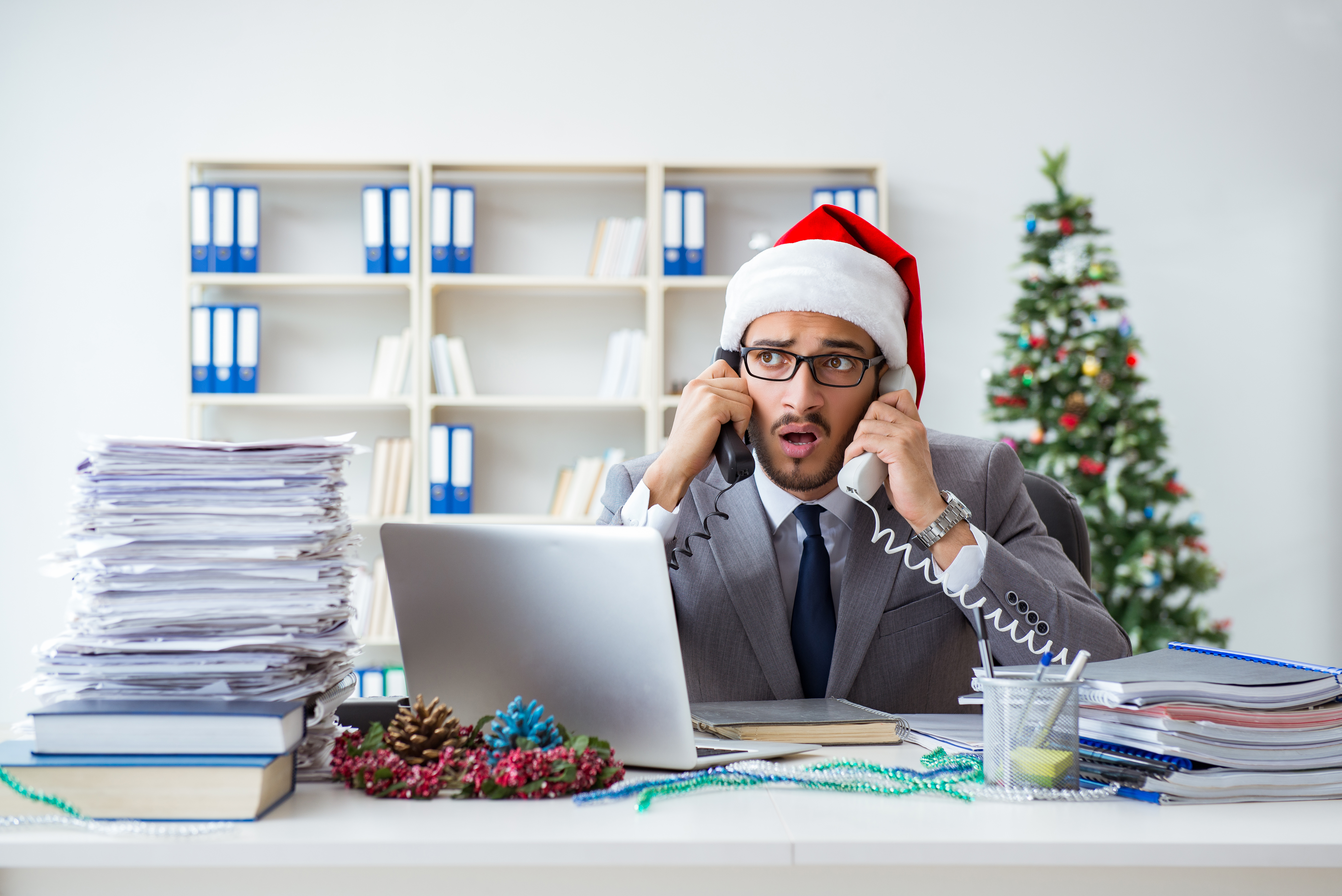 Canva - Young Businessman Celebrating Christmas in the Office