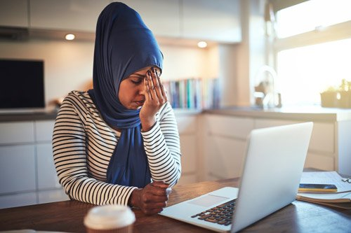 Canva---Stressed-Out-Female-Entrepreneur-Working-Online