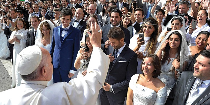 Pope Francis greets newly married couples during his general audience in St. Peter's Square at the Vatican on September 30, 2015. CNS PHOTO L'OSSERVATORE ROMANO.jpg