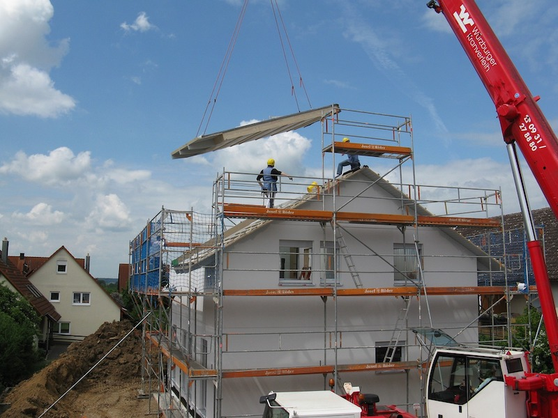 Roof being added to house