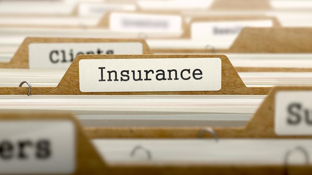 File folder labeled insurance
