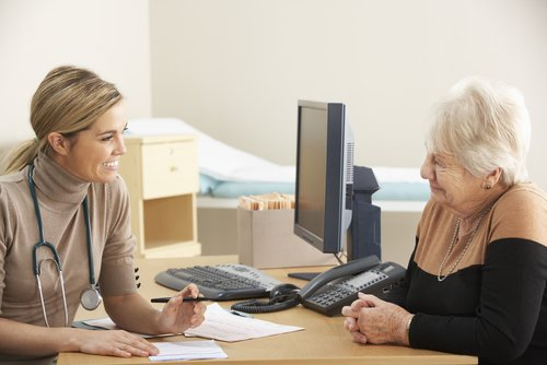 GP with patient in GP Practice consultation