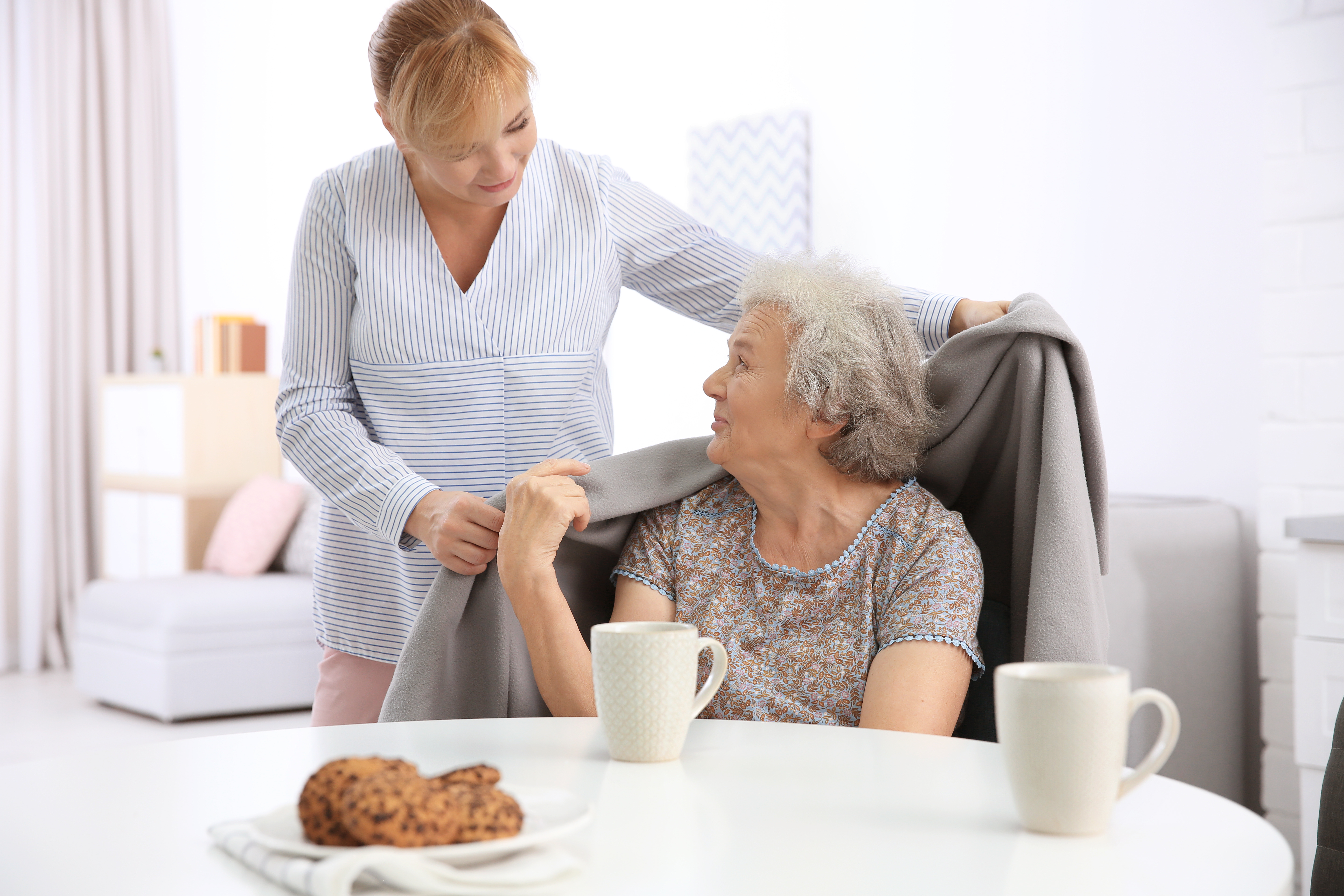 care home manager caring for elderly lady