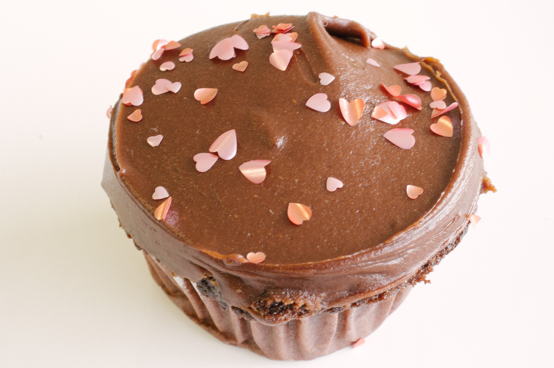 Pink hearts on a cupcake with chocolate frosting
