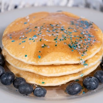 blue and silver edible glitter on pancake