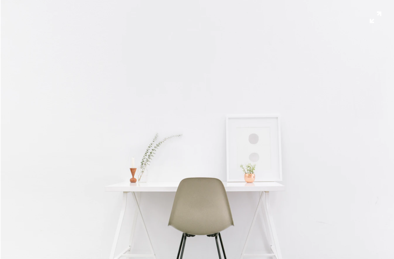 minimalistic desk against a white wall