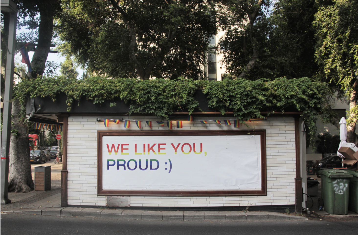 "sign on side of road that says ""we like you proud :)"""