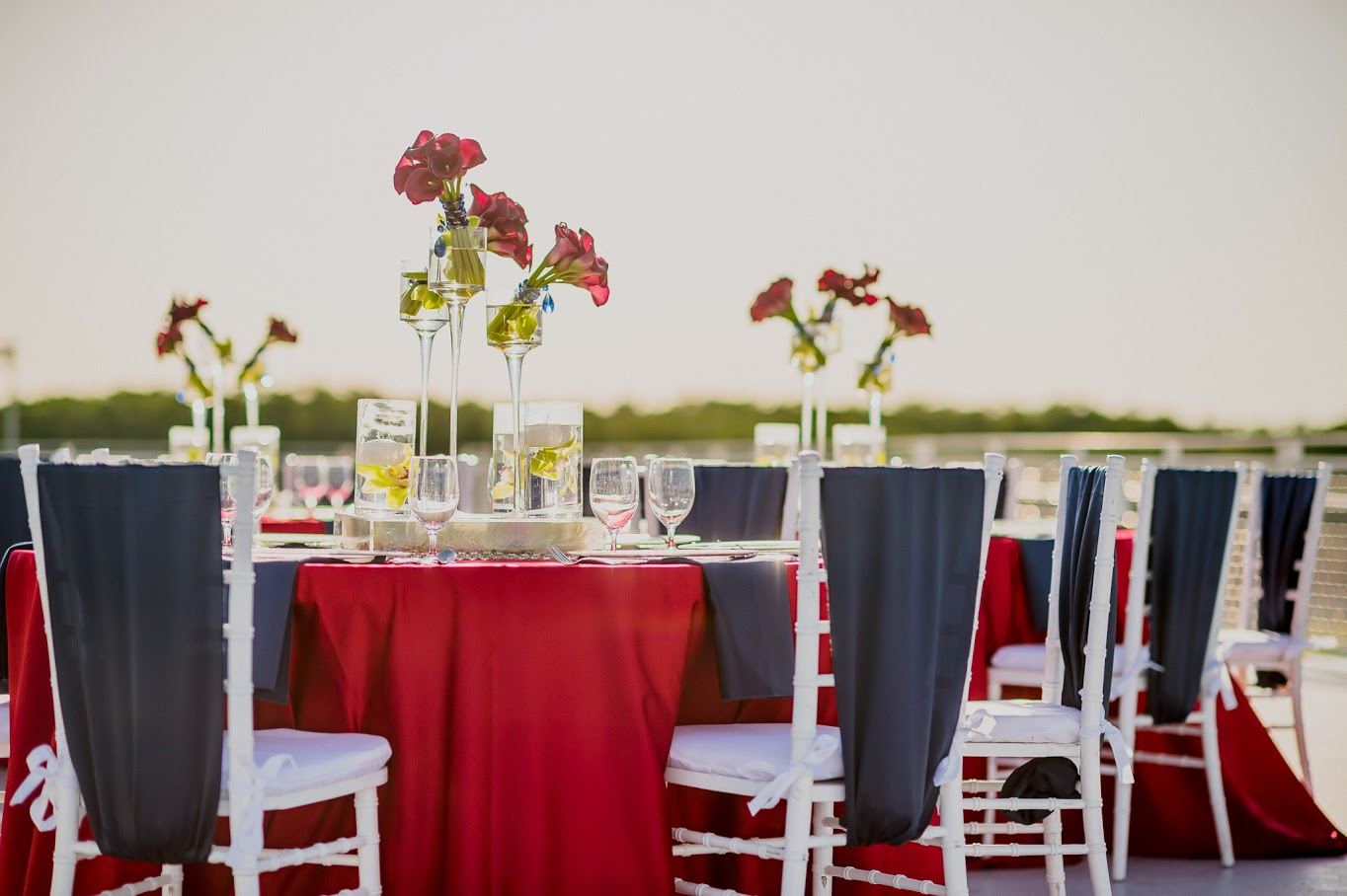 Red Lamour Table Linen with Navy Blue Lamour Chair Ties | BBJ Linen