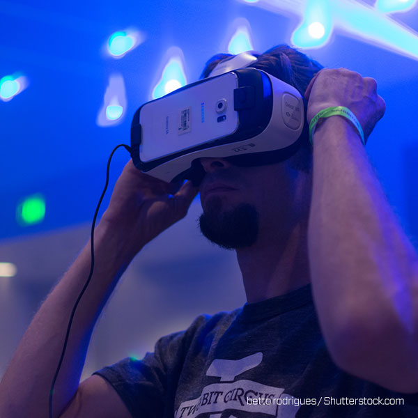 Young man using virtual reality headset