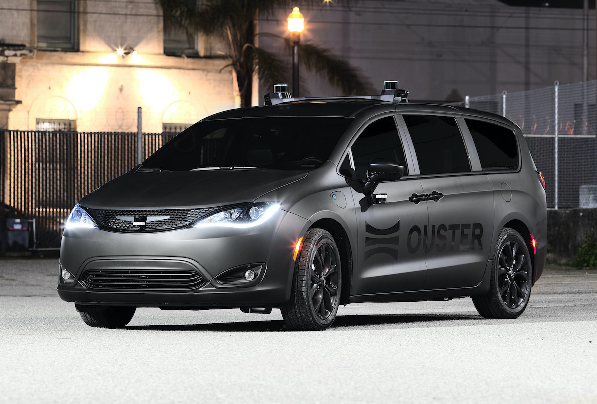 Ouster branded Chrysler Pacifica pictured with sensors at dusk