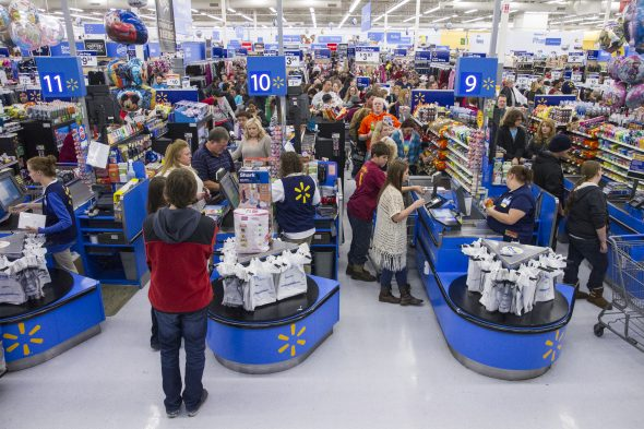 Customers wrap up their holiday shopping during Walmart's Black Friday events on Thursday November 27, 2014 in Bentonville, Ark. Deep savings continue at Walmart Friday though Cyber Monday as part of five days of events in stores and online. (Photo by Gunnar Rathbun/Invision for Walmart/AP Images)