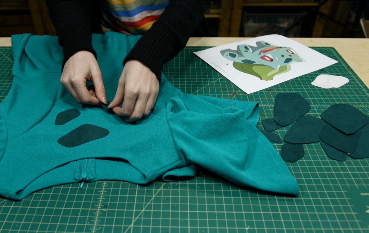 Sticking Bulbasaur spots onto cosplay dress